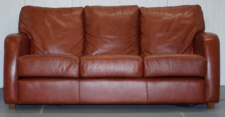 We Are Delighted To Offer For Auction This Lovely Saddle Brown Leather Three Seat Sofa