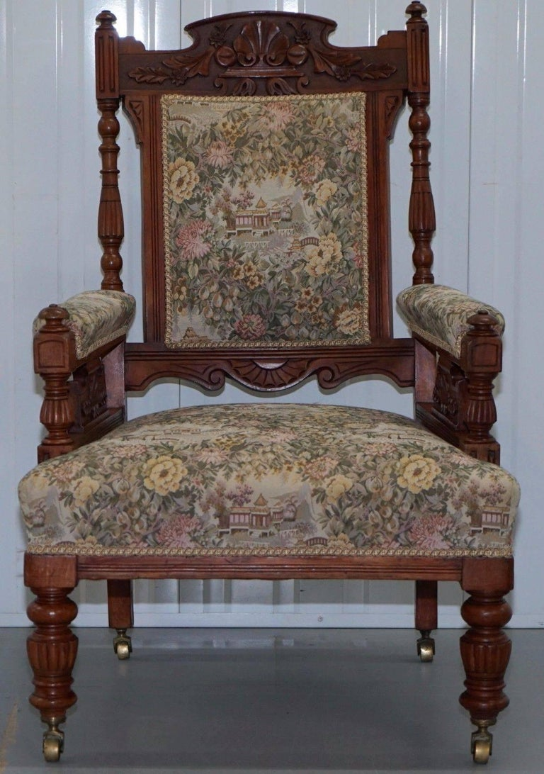 We are delighted to offer for sale this absolutely stunning Victorian oak hand-carved Library reading chair with Embroidered tapestry upholstery and Gillows style reeded legs