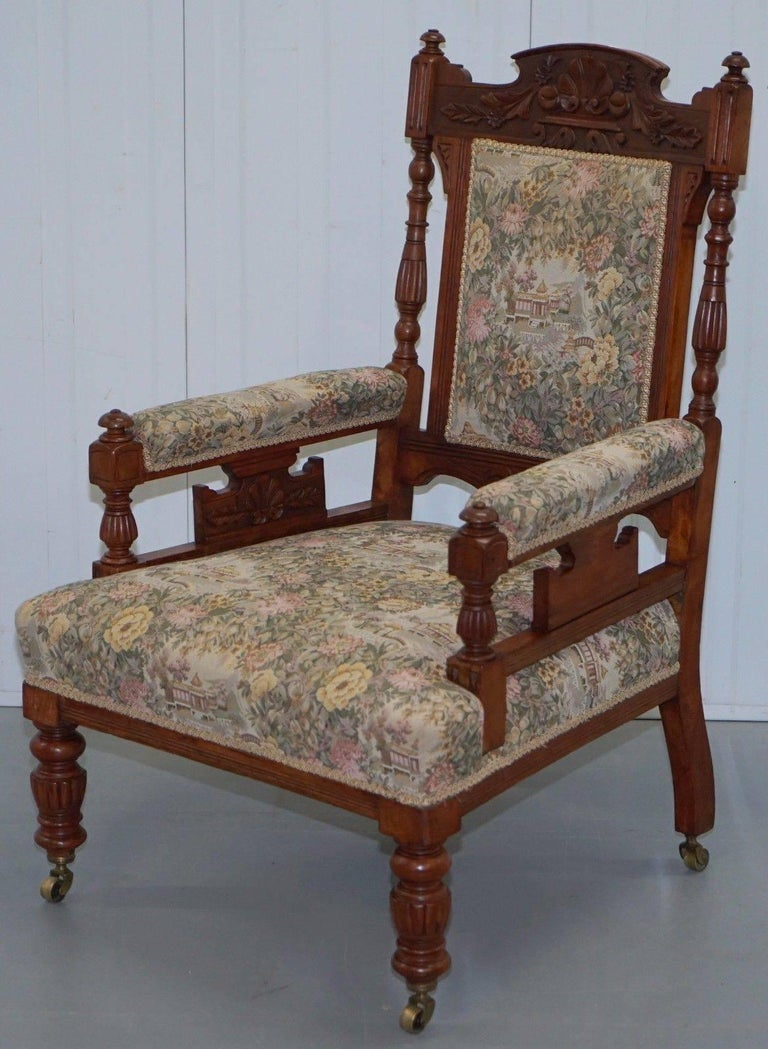 British Victorian Embroidered Carved Oak Framed Library Reading Chair Gillows Style Legs For Sale