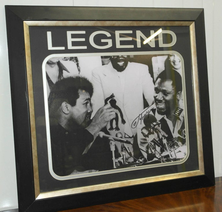 "We are delighted to offer for sale this stunning and really quite rare original signed Joe Frazier with Muhammed Ali ""Legend"" print