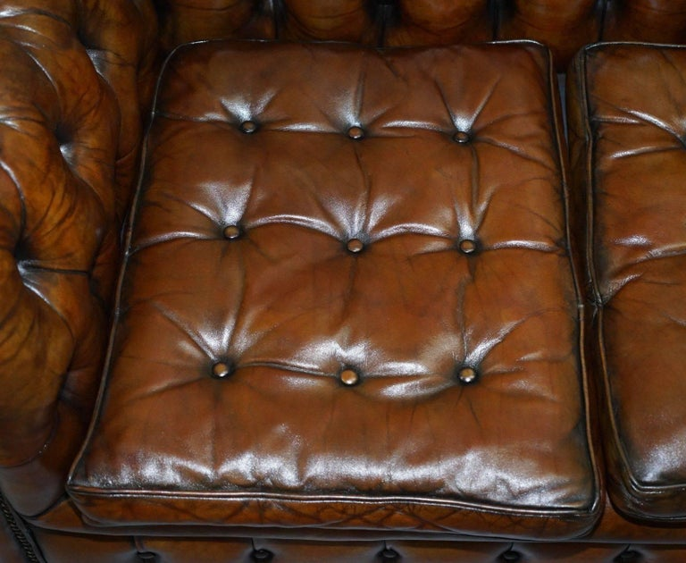 British Fully Sprung Thomas Chippendale Restored Aged Brown Leather Chesterfield Sofa For Sale