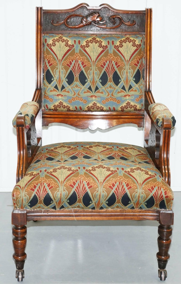 We are delighted to offer for sale this stunning Liberty London Ianthe upholstery Victorian Library reading armchair with Walnut frame 