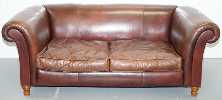 We are delighted to offer for sale this lovely vintage Buffalo leather oversized three-seat brown leather sofa with feather filled cushions