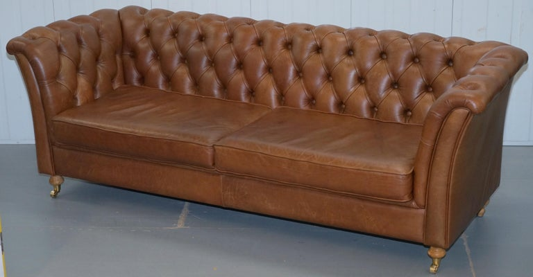 English Chestnut Brown Leather Chesterfield Sofa With Turned Oak Legs And Castors For