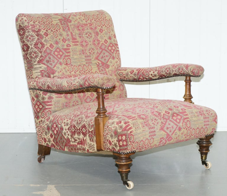 We are delighted to offer for sale this lovely original Victorian Walnut framed Kilim upholstered Howard Library reading armchair  A very good looking and well-made piece, very rare to find in original Kilim upholstery, this is a Howard model