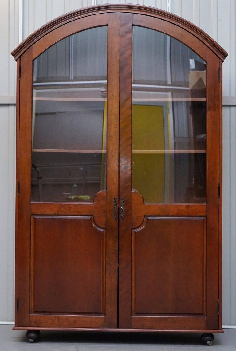 Lovely W.A.Page stamped original vintage solid Mahogany bookcase with glass doors  A really lovely thing that offers a great deal of storage space for books etc. The manufacturers plaque is stamped in a brass plate in the base which is a very nice