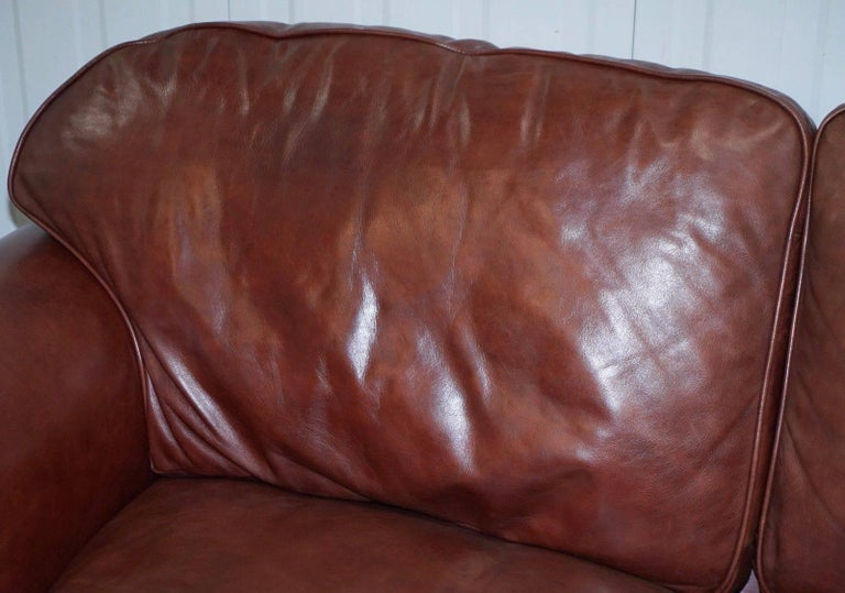We are delighted to offer for sale one of two matching lovely Heritage brown 100% cattle hide leather Laura Ashley Winchester large two and a half seater sofas RRP £2399