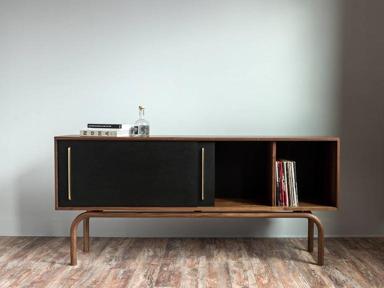 Gatsby Credenza is exquisitely handcrafted. The legs are long continued and unified bending wood. Inspired by the history and influences of the Prohibition era in the United States, Gatsby Credenza is designed to store liquors, records, and books.