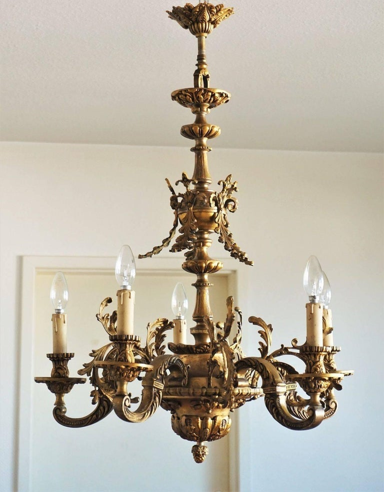 Louis XVI style solid gilt bronze five-arm chandelier extremely ornate with great details, France, circa 1870-1880. Beautiful aged patina to bronze, rewired. Five E14 bulb holders with candle covers sockets. Measures: Diameter: 27 in / 68.5