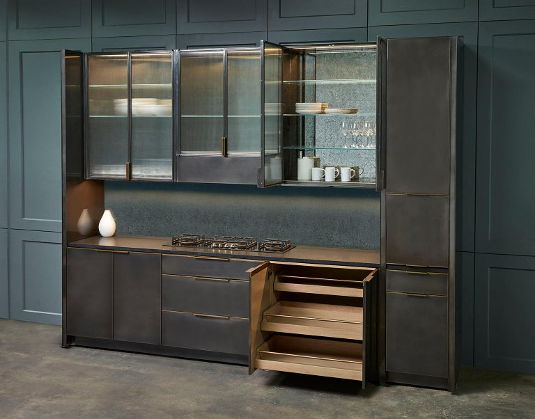 Amuneal's gunmetal kitchen is a fully bespoke kitchen system that blends individual functionality with Minimalist detailing. The interior cabinetry is fabricated from solid wood and handcut veneers offering the highest quality traditional