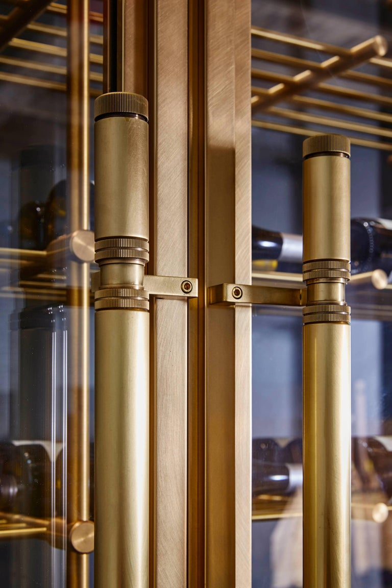 Brass Wine Room with Brass Framed Glass Doors and Pulls and Brass Wine Racks 4