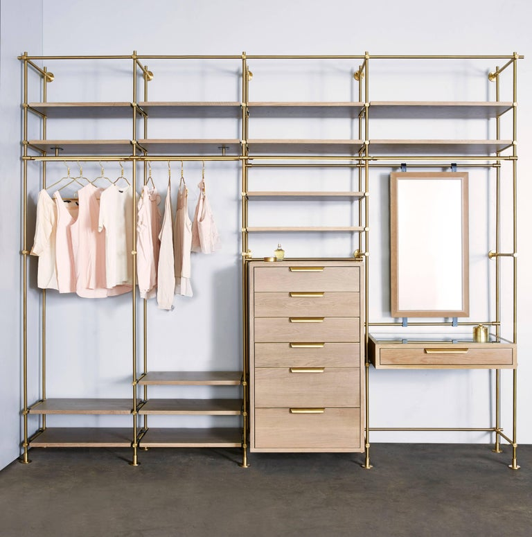 Four bays of Amuneal's collector's shelving system is used to create this modular wardrobe unit with silvered oak shelves, dresser, vanity table and mirror. The precision design and machining of the Collector's fittings allows this unit to be very