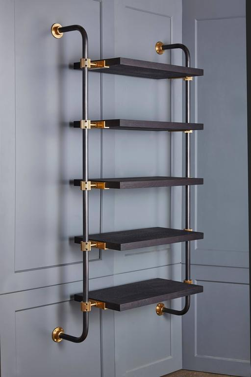 This single bay of our Loft Shelving is wall-mounted to support five shelves, using custom machined brass fittings on bent steel posts. Amuneal's proprietary machined hardware clamps onto the posts so that the shelves can be easily adjusted at any