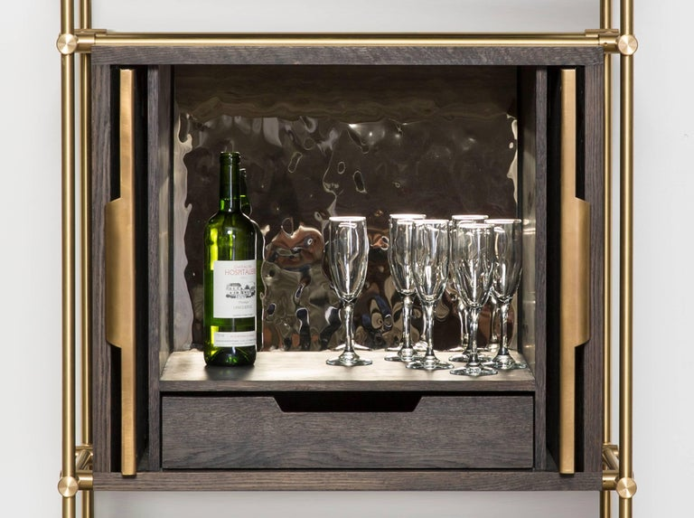 This single bay collector's shelving unit highlights our carved oak wine shelves as a perfect way to store and display your favorite bottles. Our precision machined brass fittings make each shelf easily adjustable and removable adding to the curated