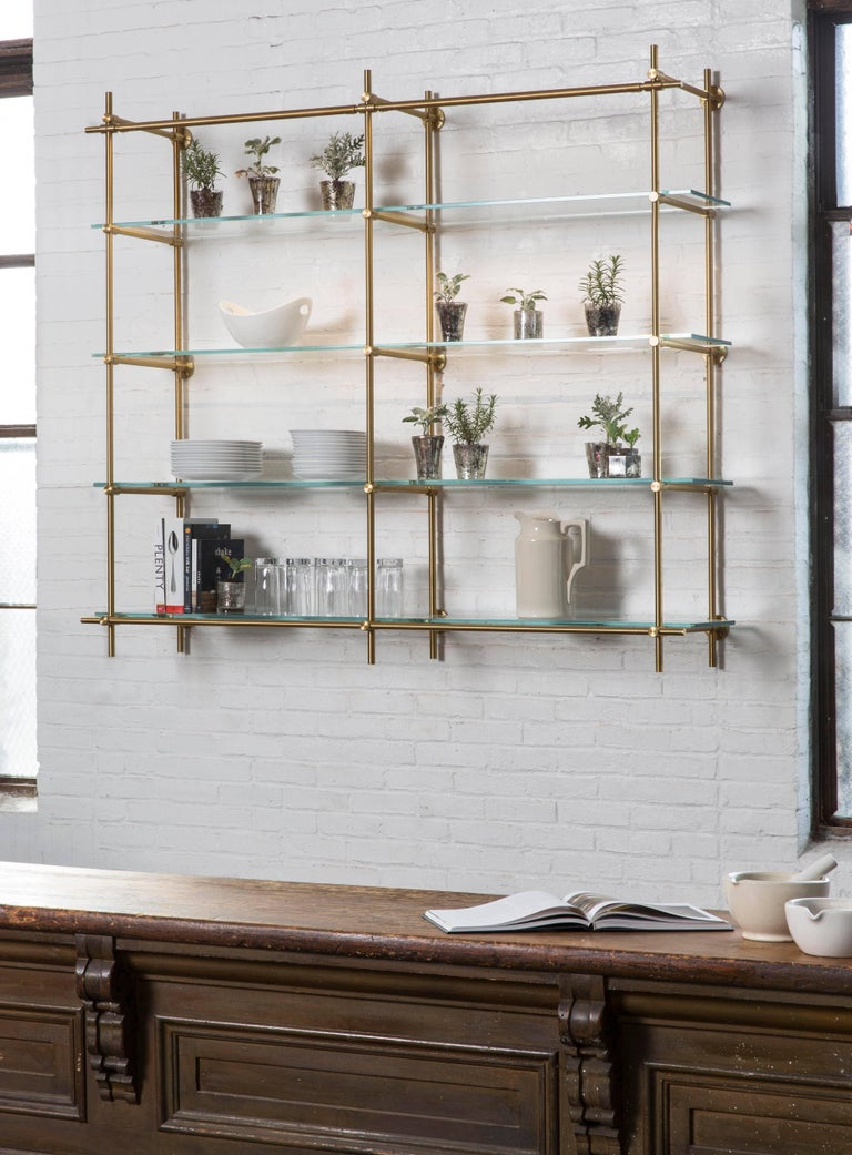 This two bay hanging shelving unit is part of Amuneal's Collector's Shelving System and features our precision machined brass fittings and tubes in a hand applied warm brass finish. The upper horizontal tube contains integral LED lighting to