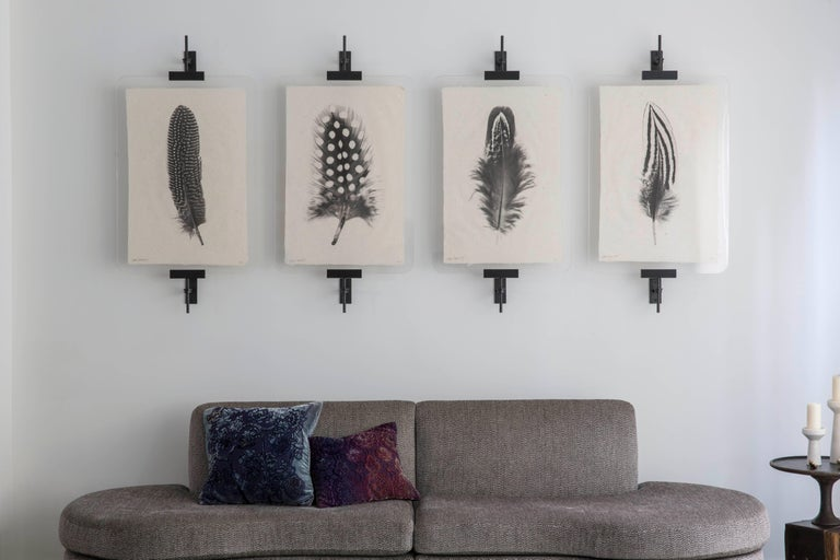 "Amuneal's modern easels offer a sculptural display system for your favorite artwork and photos. Our blackened steel and aluminum supports clamp your images between two sheets of ?"" thick acrylic with polished edges. The blackened steel supports"