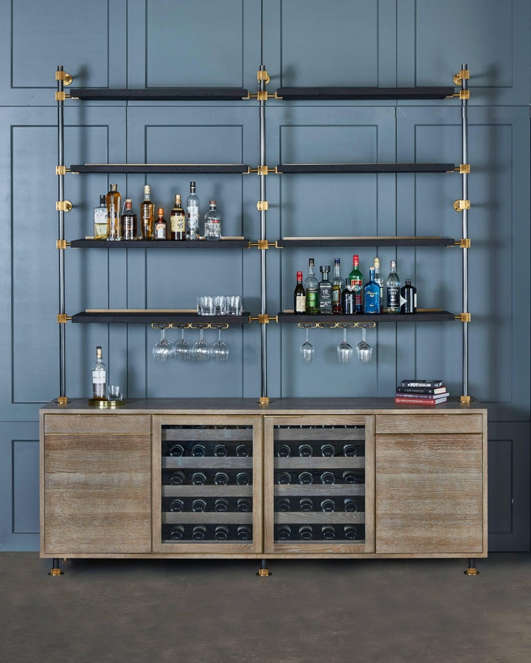This beautiful bar cabinet with burnt oak adjustable shelves is part of our loft shelving collection. Our loft posts in blackened gunmetal and fully machined brass fittings in our buffed brass finish mount from the top of our cabinet and tie back to