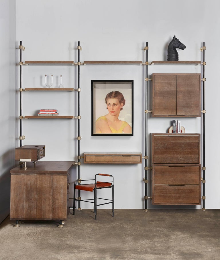 The loft work suite is a modular office system based on Amuneal's loft shelving system. Posts in blackened steel are coupled with solid brass machined fittings in a champagne finish. The posts mount from floor to wall and the adjustable fittings