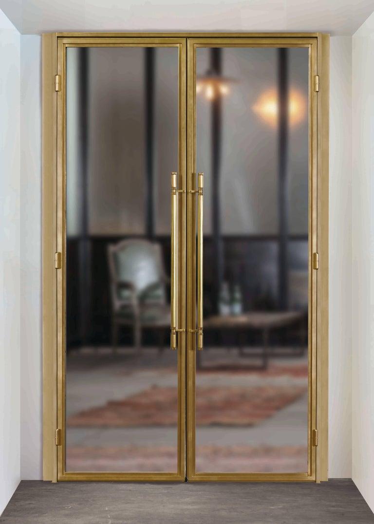 Clean Modern Bronze Doors With Machined Bronze Door Pulls