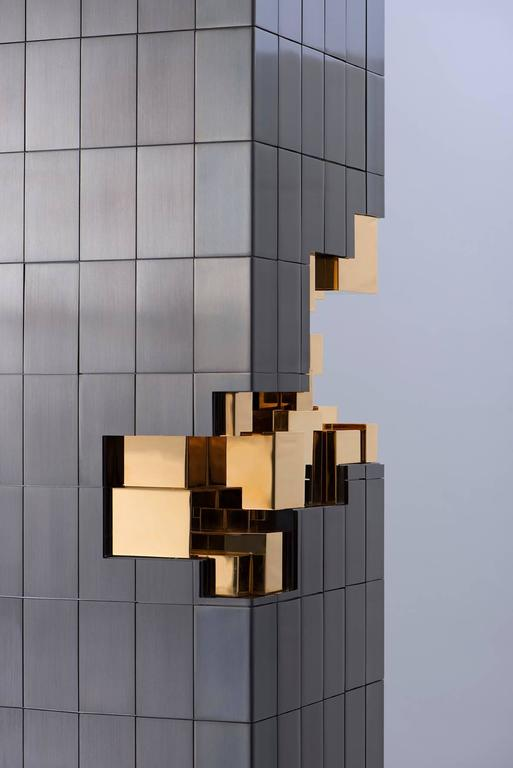 Tower sculpture Inspiration: David Collins's tower in Bangkok Made of brass: Gun metal and 24 carat gilded.  On stock at United Kingdom, London Unit C9 Ground Floor, Design Centre East, Chelsea Harbour, SW10 0XF