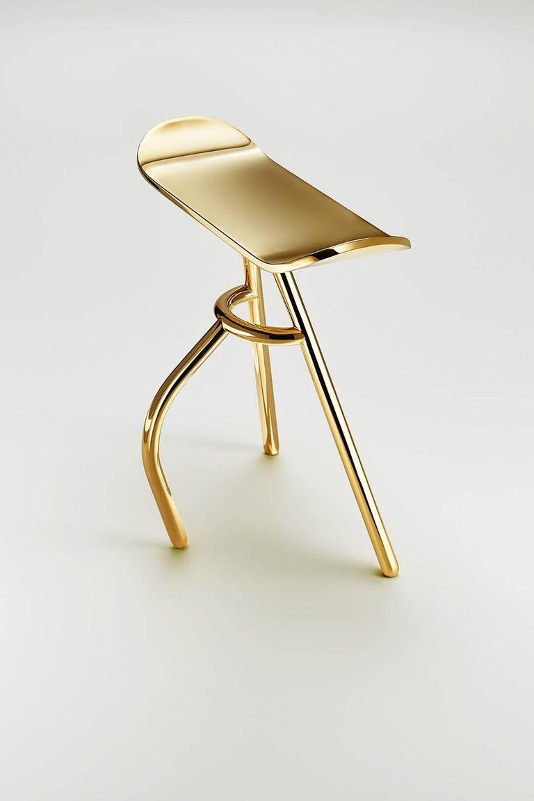 The stool is a standing stool made of brass designed by Kossi Aguessy, made in France, different finishes available.