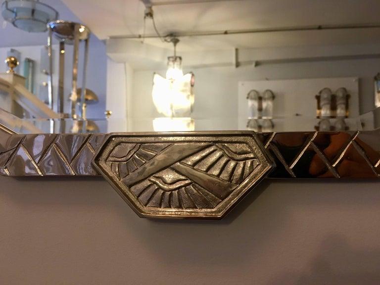 Art Deco bronze mirror with nickel finish.