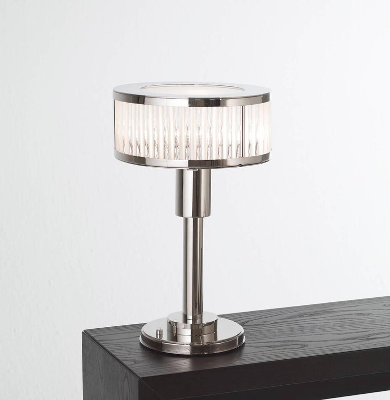 Art Deco table lamp with nickel finish and glass rods.