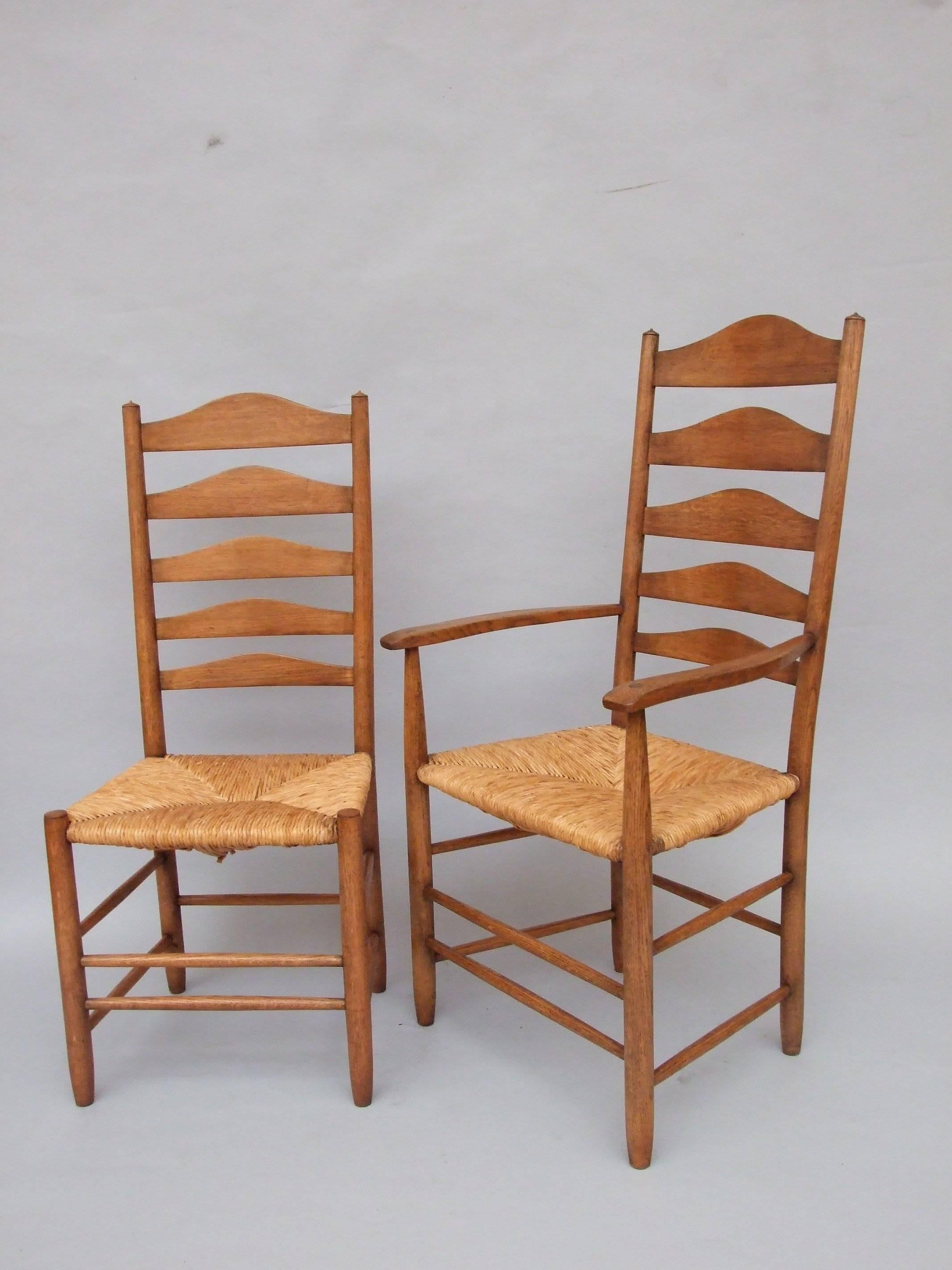 A Set Of Six Oak High Back Ladder Back U0027Clissettu0027 Chairs (one