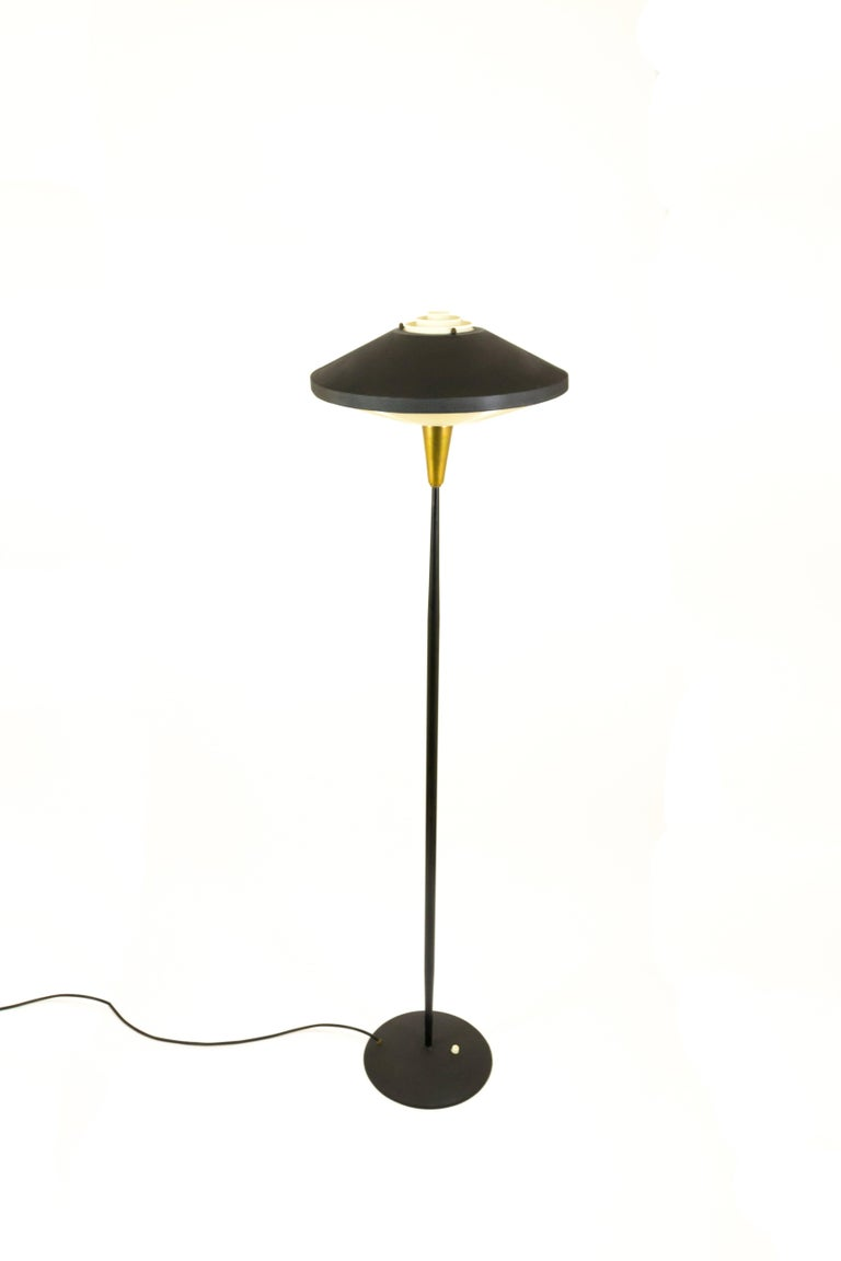 Black floor lamp by louis kalff for philips in metal and brass mid century modern black floor lamp by louis kalff for philips in metal and brass aloadofball Image collections