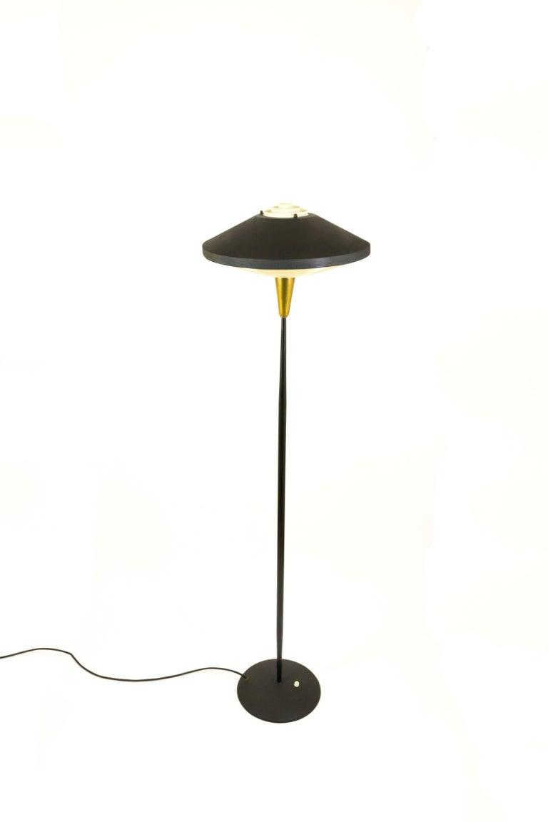 Black floor lamp by louis kalff for philips in metal and brass mid century modern black floor lamp by louis kalff for philips in metal and brass aloadofball Gallery