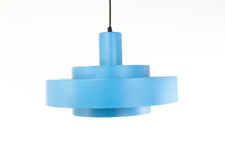 This blue Equator pendant lamp was designed by Jo Hammerborg for Fog & Mørup. The lamp was first advertised in the Fog & Mørup catalogue from 1969. It is part of the so-called Rainbow Line series, which also included other earlier designs in new