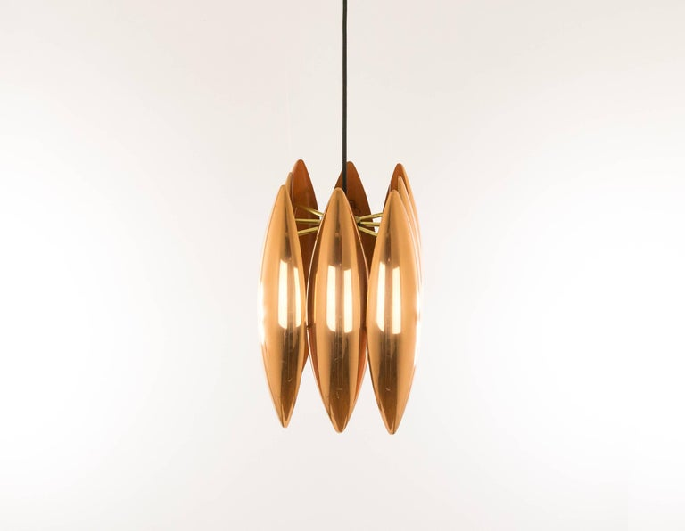 Jo Hammerborg designed the 'Kastor' pendant for Danish manufacturer Fog & Mørup.  The 'Kastor' series consisted of three different models: a pendant, a wall lamp and a floor lamp, all executed in solid copper or brass. The striking brass models were