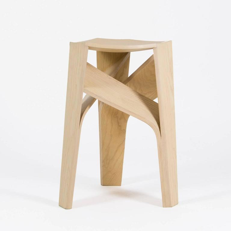 Aero stool is the result of mastering the process of bending wood, it features a geometrical intersection of its three legs, a technical feat achieved through meticulous digital and artisanal methods. The shape of Aero is an ingenious solution that