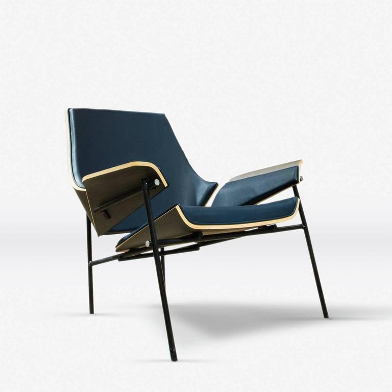 """This lounge chair draws inspiration from the iconic """"Red & Blue Chair,"""" from Gerrit Rietveld and mixing this with a wood bending technique developed by LEFT, Victor Aleman design, combines 3D modeling and Handmade wood shaping to create a modernist"""