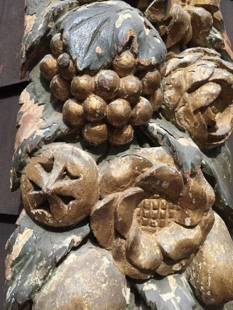 French wooden carvings of fruit and flowers are highly