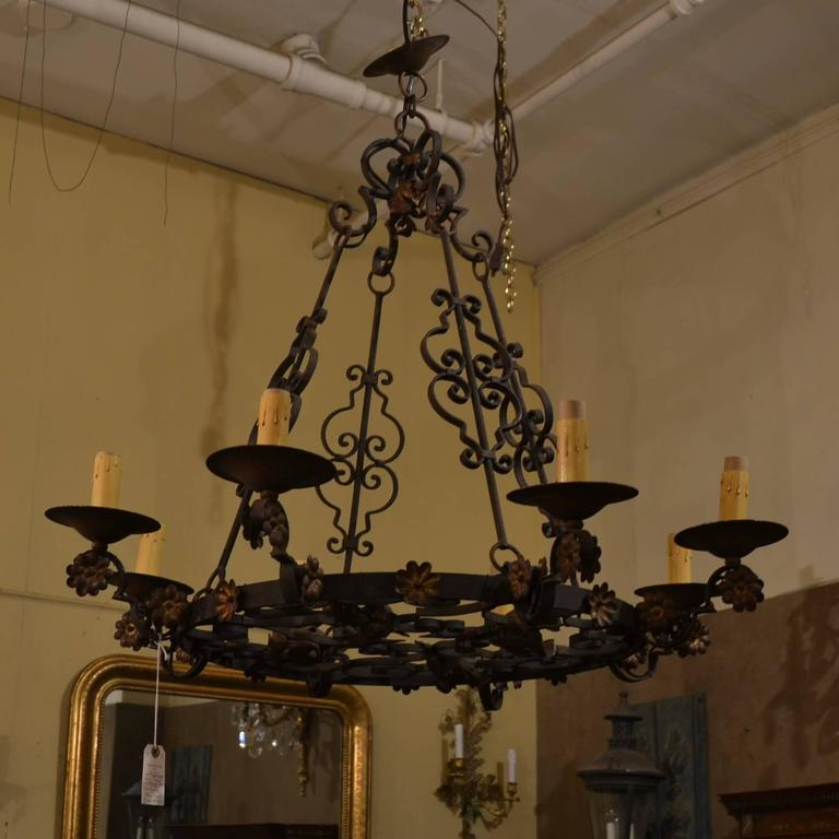 Antique French wrought iron eight-light fixture with floral detail, circa 1890-1910.