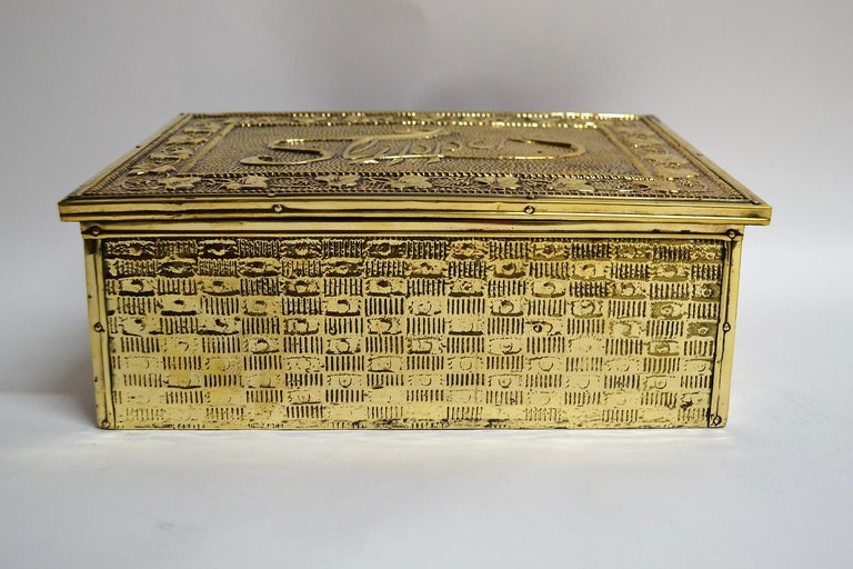 Antique English brass slipper box. This box is lined with wood, and it would have been placed near the fireplace to warm one's slippers.