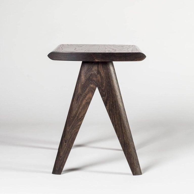 A fun and versatile stool fit for any space. The mixture of soft edges and firm lines create a comfortable seat and an intersection of shapes. With it's flat top this piece works well as an entryway stool or can even be utilized as a side table. The