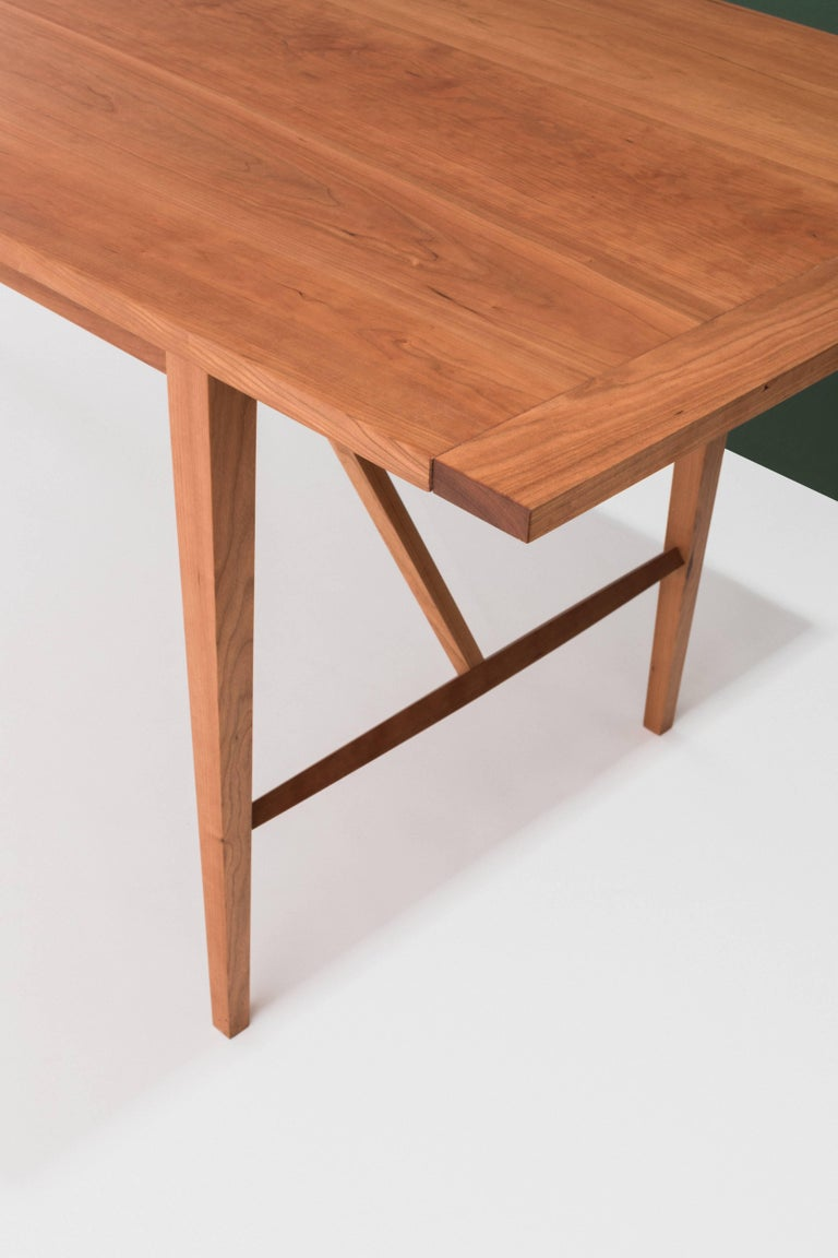 This lightweight yet sturdy dining table draws from Classic farm and Shaker table design. The slim profile and slightly shaped and tapered legs lend an elegance to the piece. 