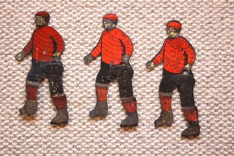 A delightful and highly decorative set of six coloured tinplate sports figures. As they have a kicking action we think they are possibly English or American footballers. If anyone knows we would love to hear from you!  They would make a great
