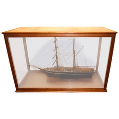 "Model Ship ""Raven"" in a Wooden Glazed Display Cabinet"