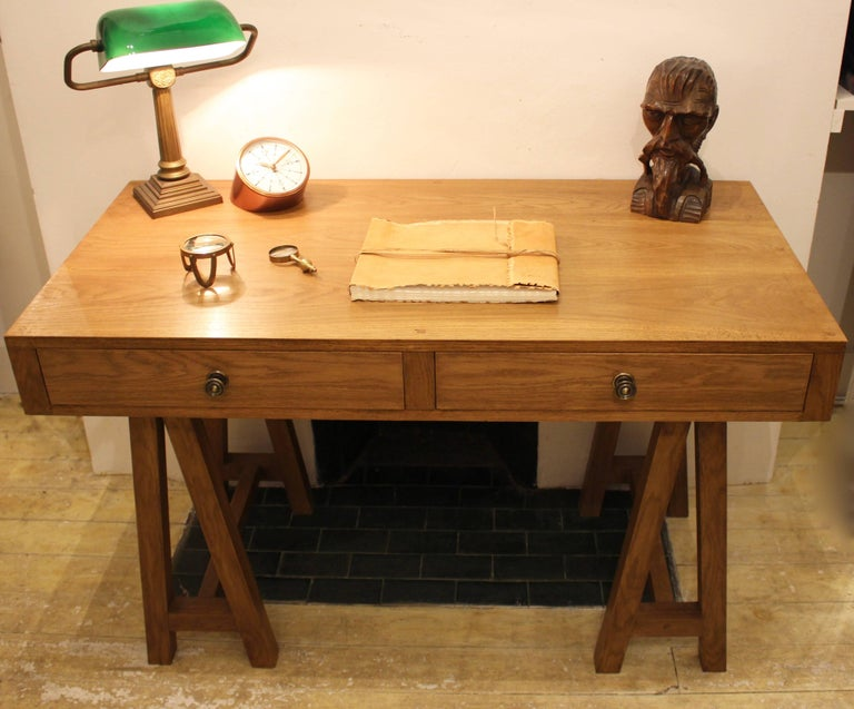 One of our best selling bespoke items. Handcrafted from solid oak and made to order at our workshop in Sussex, England. With its classic clean lines, dove-tailed drawers and solid brass knobs, this desk would sit well in a modern or traditional