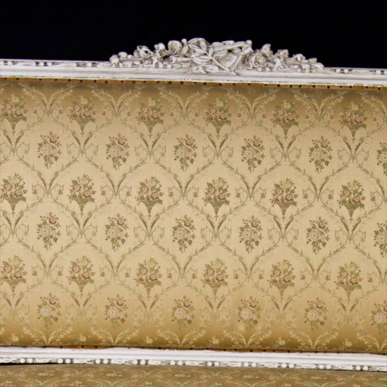 Late 19th century antique Swedish Gustavian sofa in later white paint with intricate carved canework , scroll detailing, rosettes, fluted legs and central carved relief.  Immense detail is really pleasing on the eye and unusually it has the two