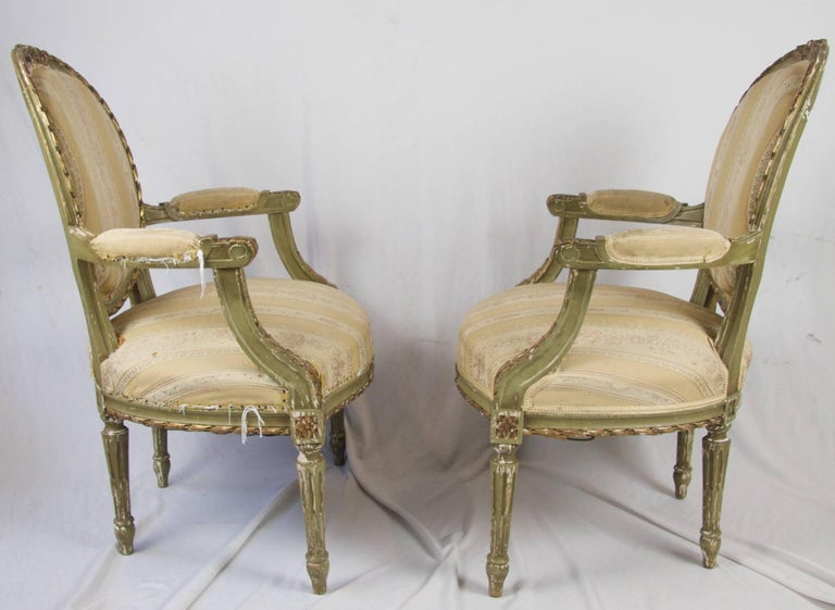 Very beautiful unusual Swedish antique Gustavian carver chairs intricately decorated with carved canework, acanthus leaf motifs and bow carvings.  Super comfy fully sprung seats and webbed back. Original gilt finish has developed a lovely patina