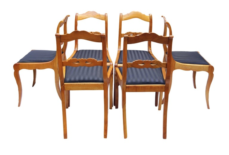 Set of six chairs, Biedermeier around 1825, solid cherrywood. The chairs were new re-upholstered. Measure: Seat height 46 cm. In very good restored condition.