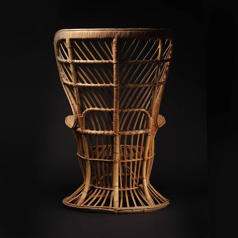 A wicker armchair designed by Lio Carminati and made by Vittoro Bonacina & Co, Como. Whilst working on the refit of the ocean liner