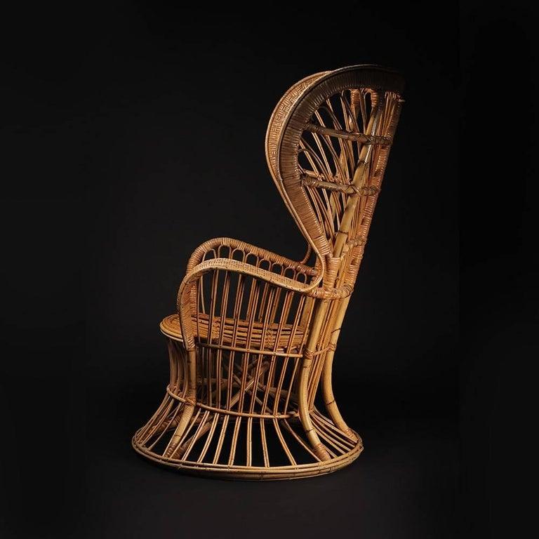 Mid-Century Modern Wicker chair designed by Lio Carminati For Sale