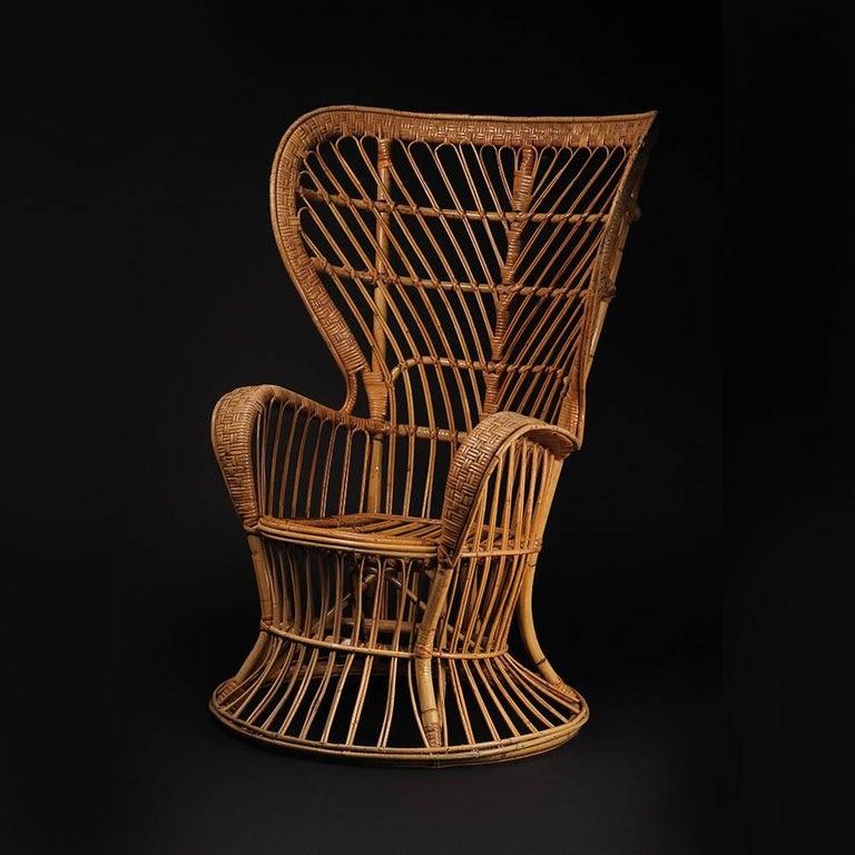 Italian Wicker chair designed by Lio Carminati For Sale
