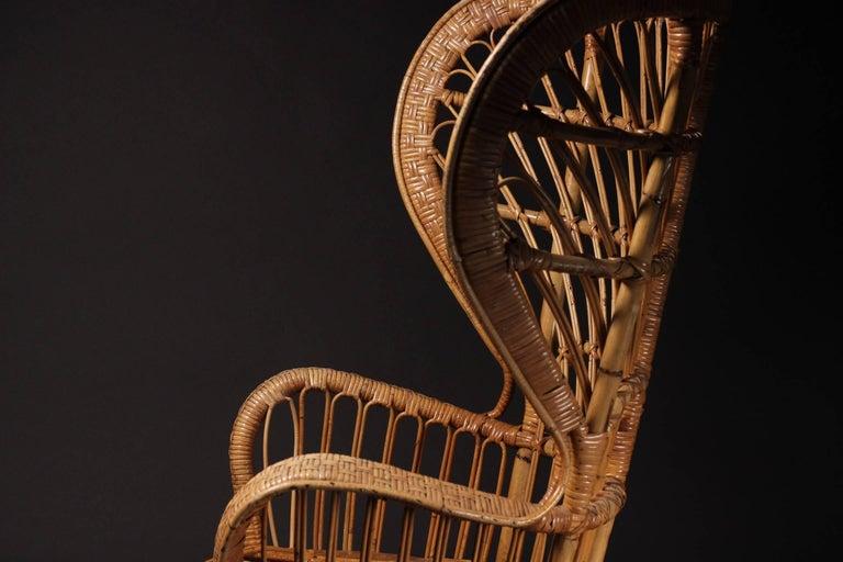 Bamboo Wicker chair designed by Lio Carminati For Sale