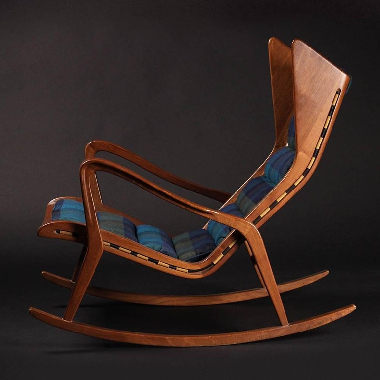 An incredible and very rare rocking chair (has been attributed to Gio Ponti in the past and shows a strong and striking resemblance to his designs) in walnut, rubber and fabric for Cassina, Italy, 1950s. Exquisite production techniques used which